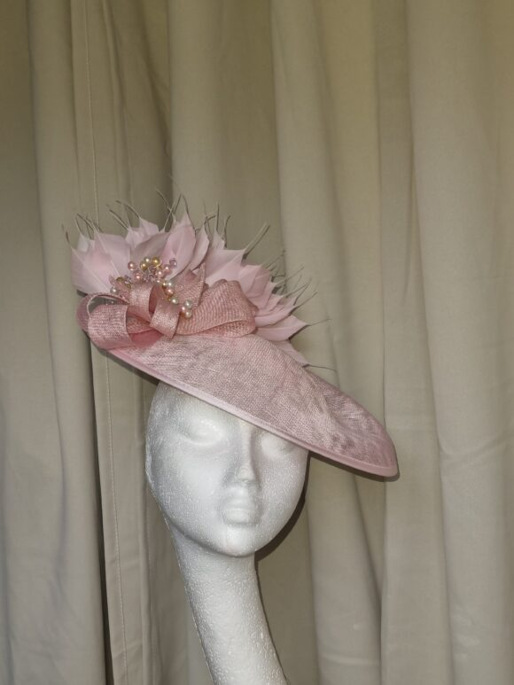 Pink saucer style hat with pink feathers and beads detsil